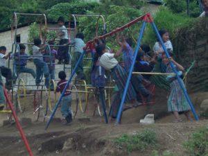 Happy children on swing set