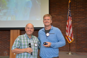 Mike Caruso presents PHF Pin to Dr. Eric Burgquam 052417